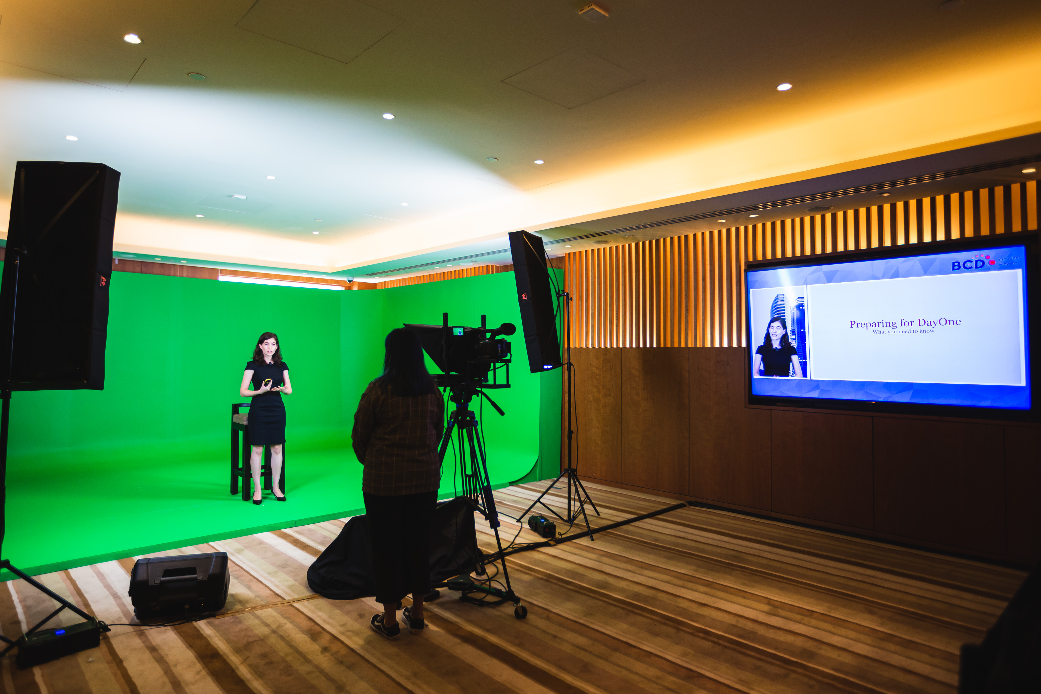 Virtual speaker standing in front of green screen and camera for Hybrid Event Showcase | Global agency, BCD Meetings & Events