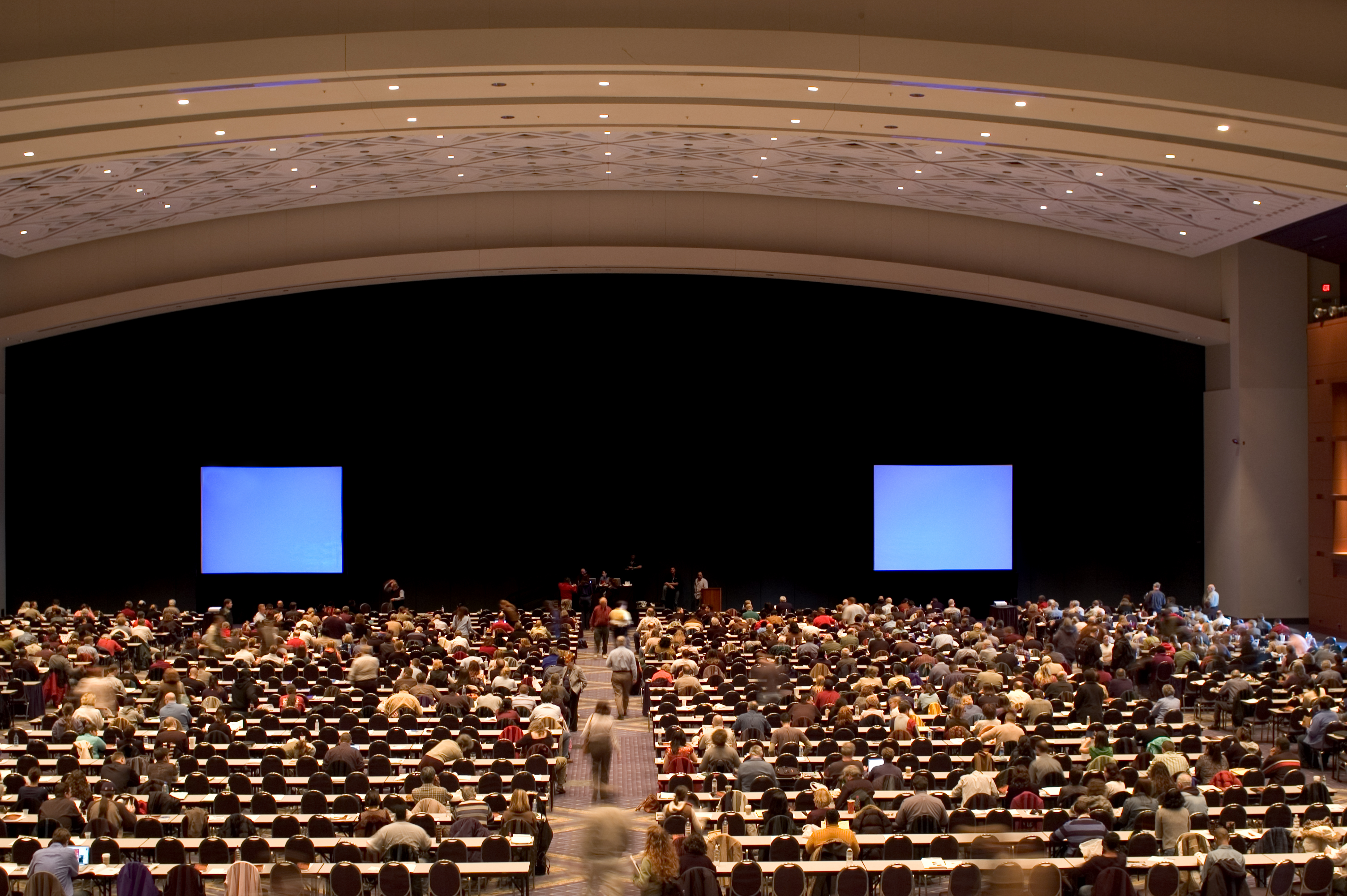 Attendees social distancing while attending corporate meeting | Global agency, BCD Meetings & Events