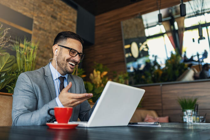 Man participating in a Virtual Meeting on his laptop | BCD Meetings & Events
