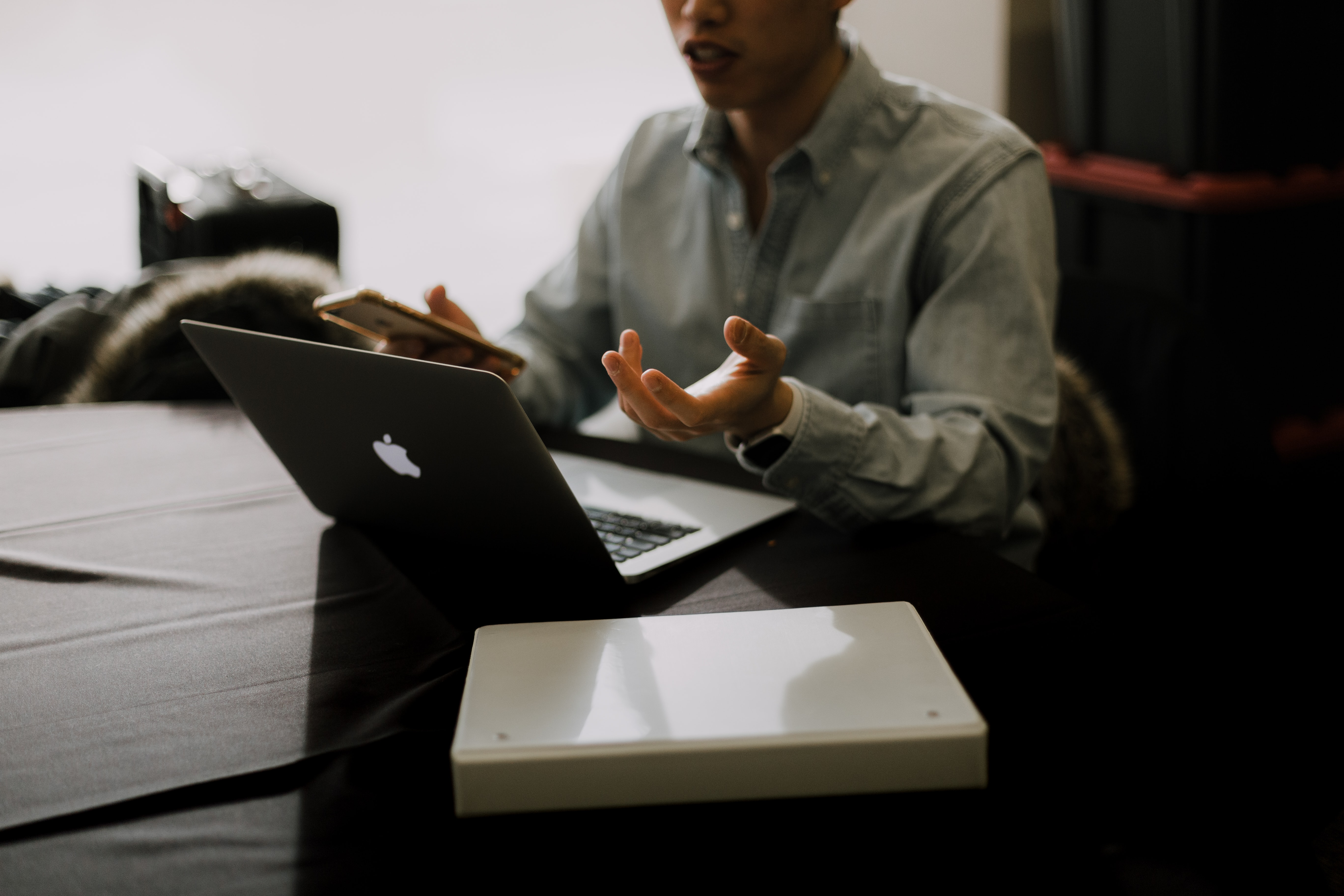 Man working at laptop on planning 2021 meeting program strategy   Global agency, BCD Meetings & Events