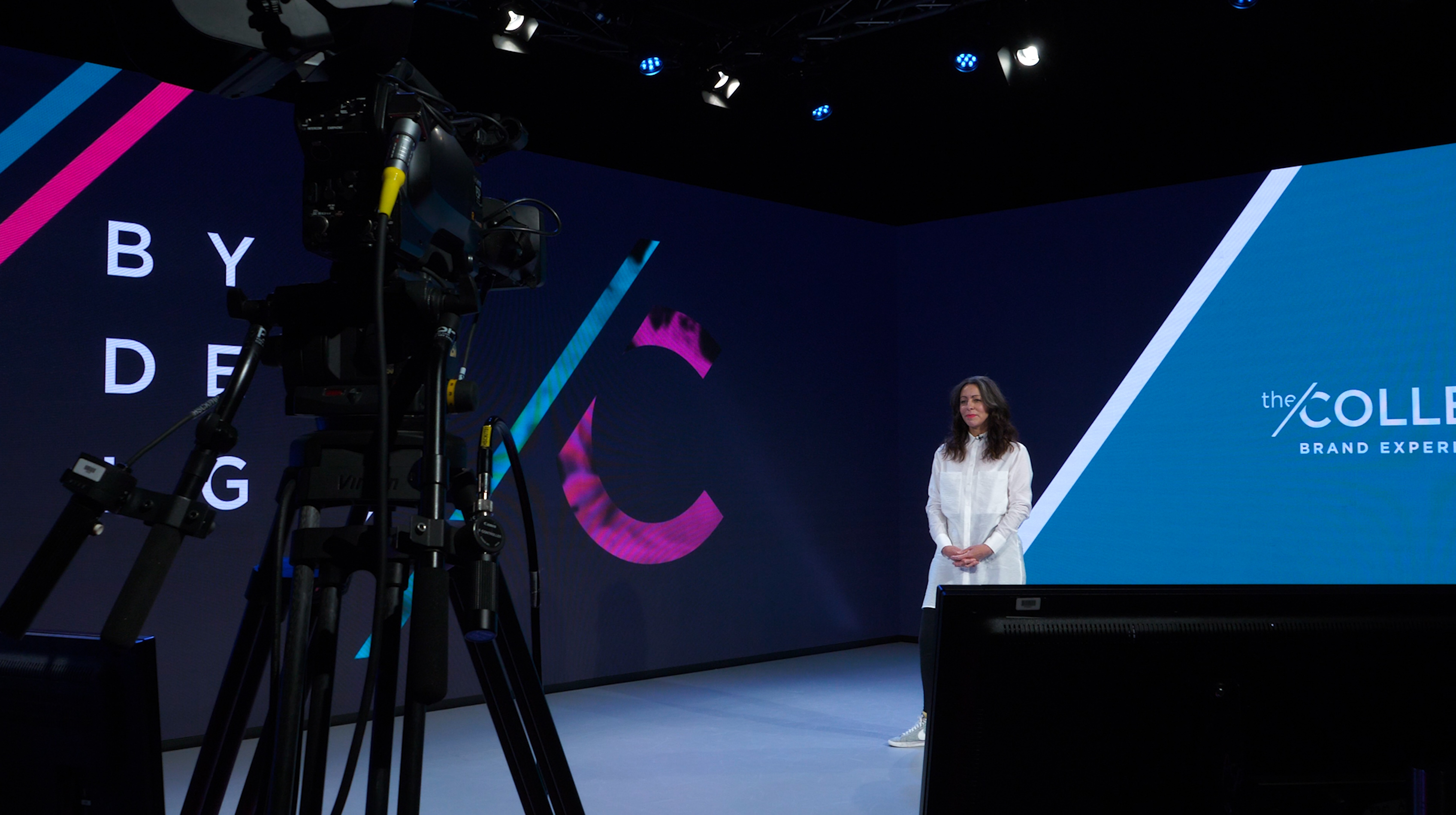 Emma Coleman of BCD M&E's The Collective presenting on stage during a Virtual Event