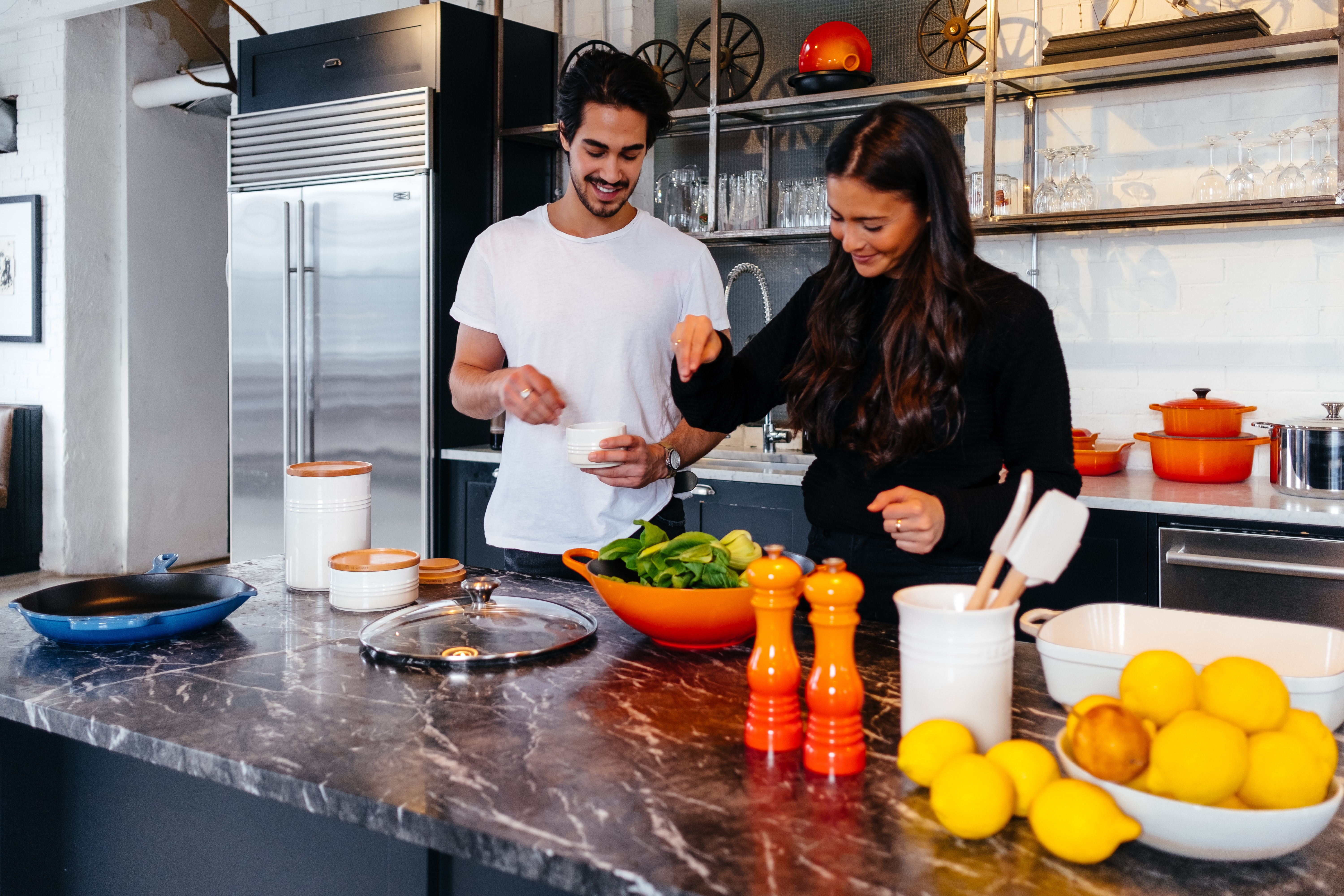 A man and woman cooking together in a kitchen as part of an Incentive Experience | BCD Meetings & Events