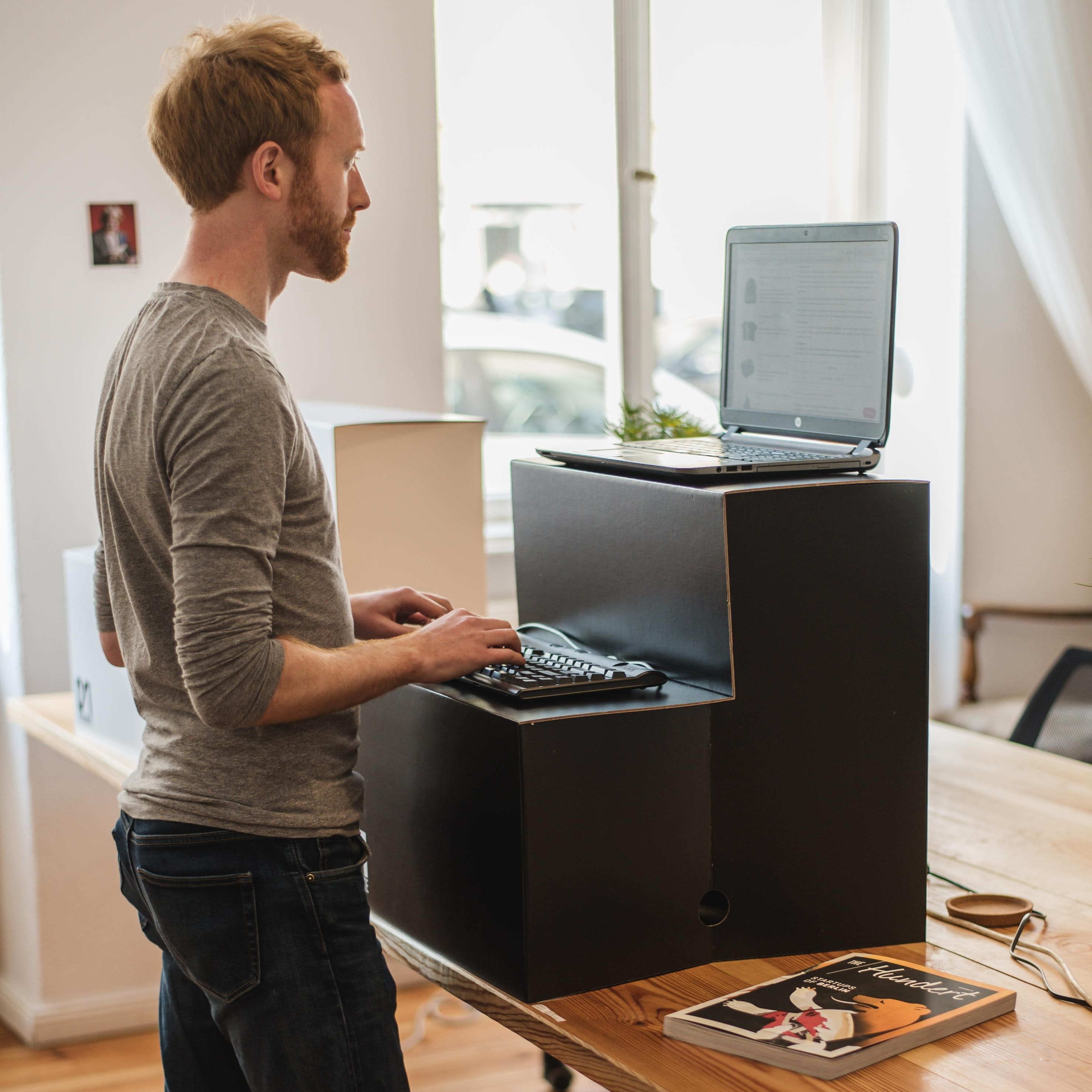 Man working on laptop at standing desk | Global agency, BCD Meetings & Events