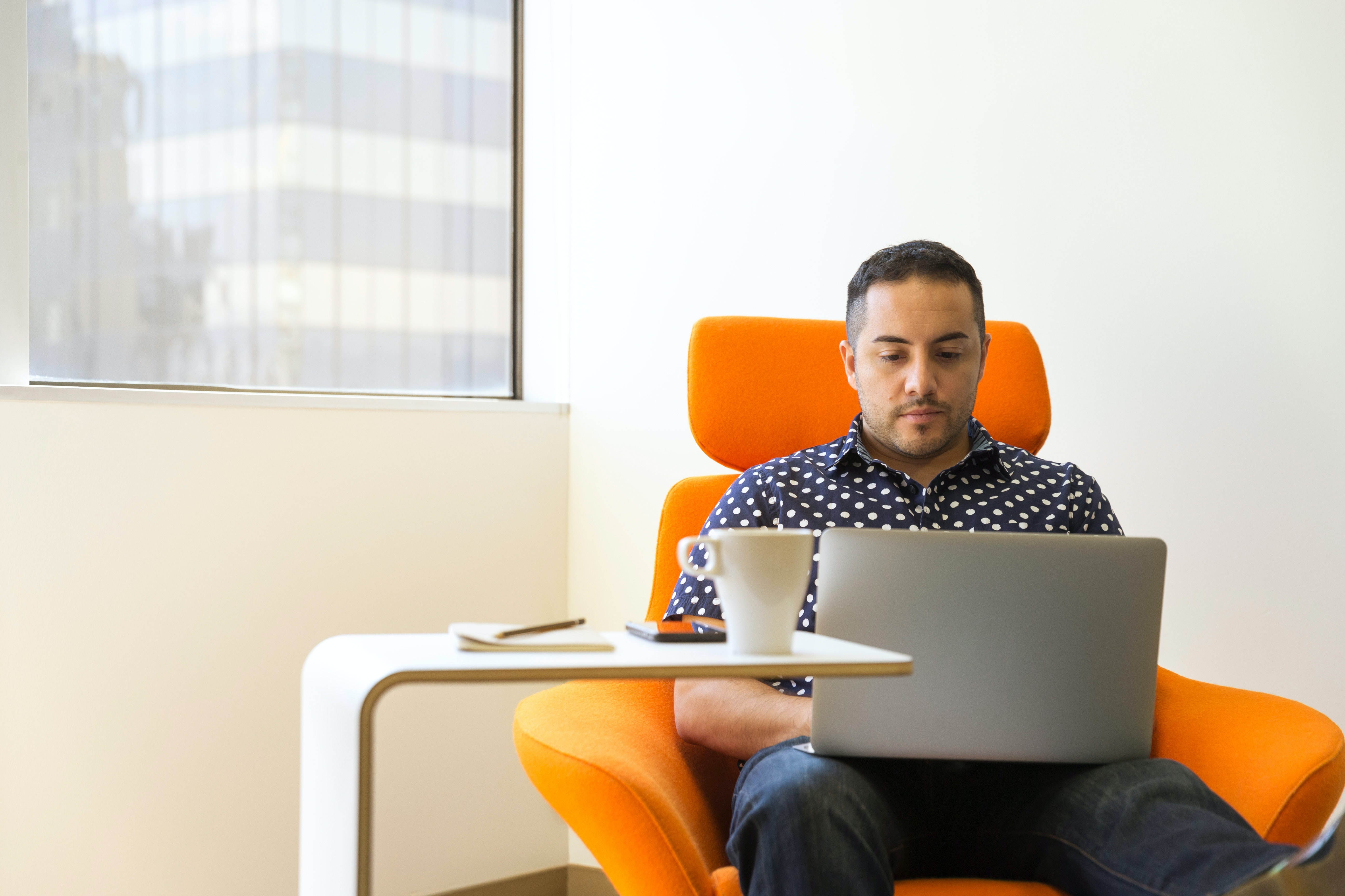 Man using laptop to participate in Virtual Incentive Event   BCD Meetings & Events