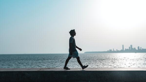 man-walking-near-body-of-water-1466852