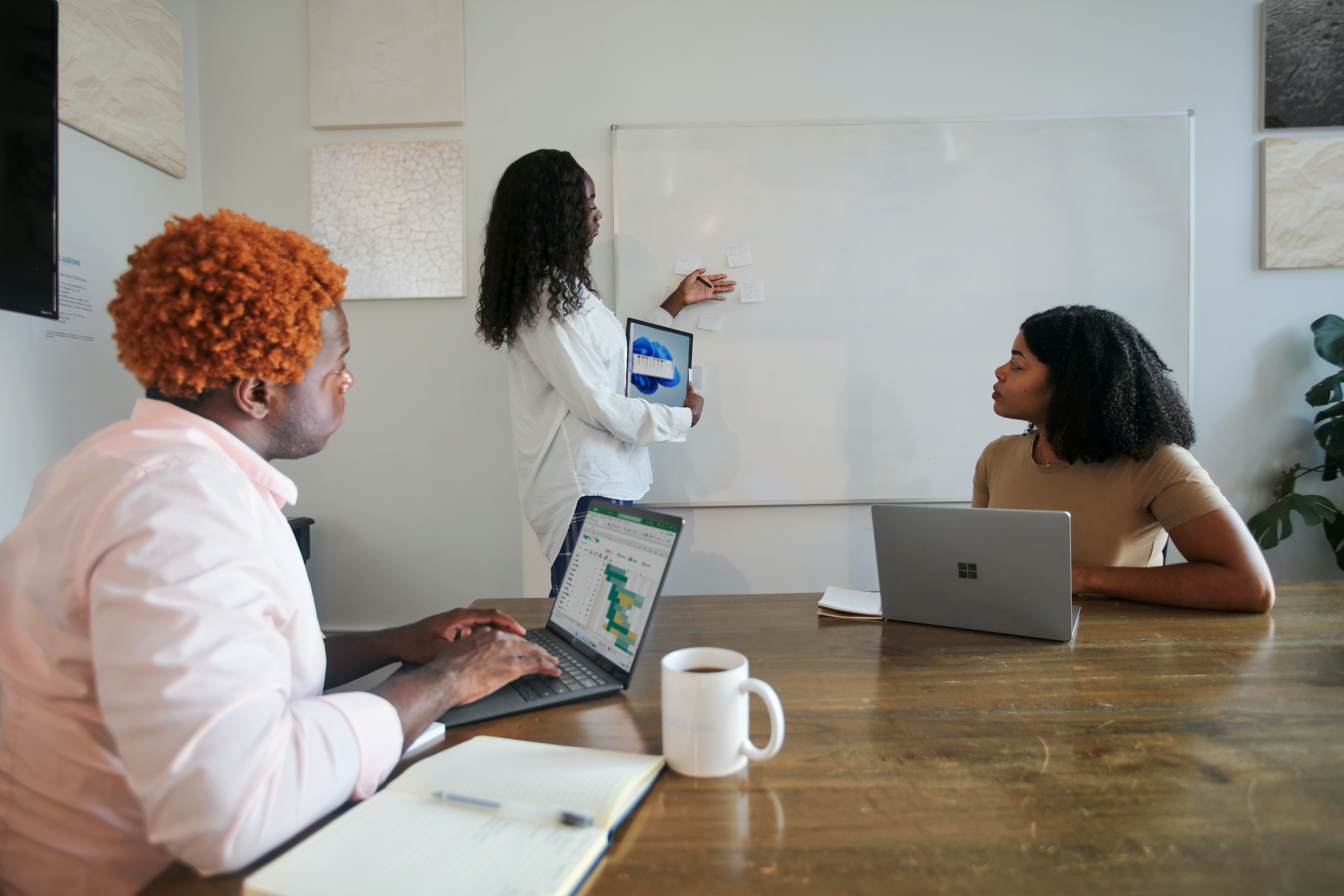 Group of meeting professionals sitting in conference room | Global agency, BCD Meetings & Events